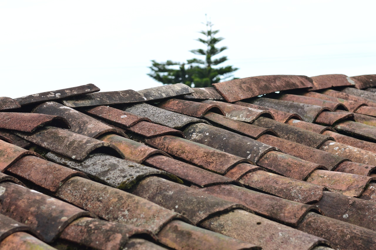 tiled roof with misaligned and loose tiles